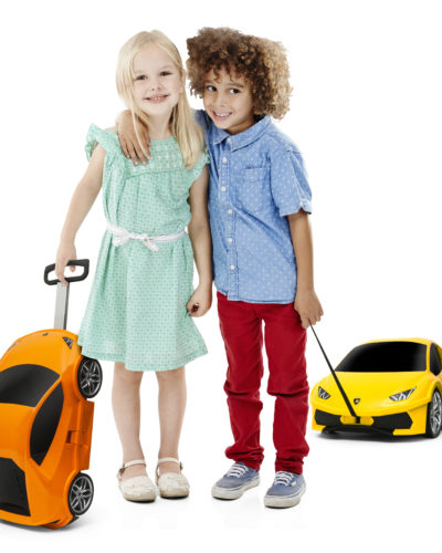 Studio shot of a cute little boy and girl posing together against a white background